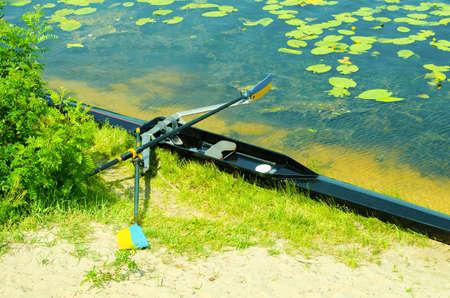 academy: Single academy rowing boat on the beach