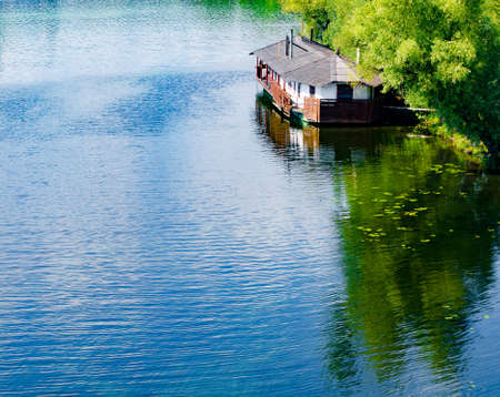 Wooden house on the river. Summer