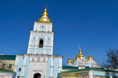 St. Michaels Golden-Domed Monastery with cathedral and bell tower seen in front of St. Michaels Square in Kiev, Ukraine Stock Photo