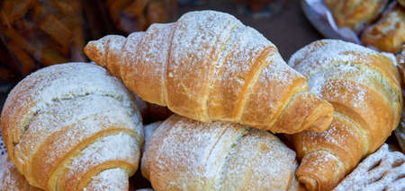 buttery: Tasty croissants with spikelets on colour background