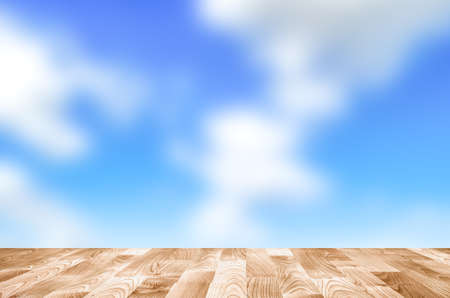 Empty wooden table with blue sky bokeh Stock Photo