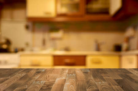 Empty wooden table with kitchen bokeh