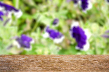 Empty wooden table with garden bokeh for a catering or food background Stock Photo