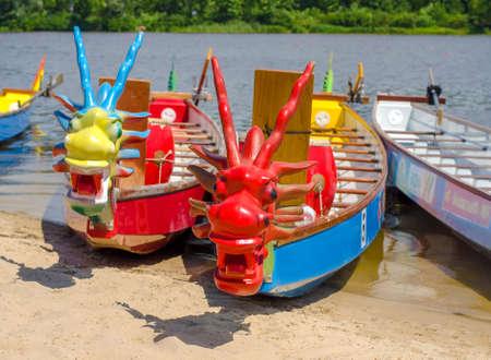 KYIV,UKRAINE-25 JUNE,2016 Dragon Boat Festival. Decorated dragon boats are anchored on the river Editorial