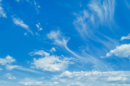 White clouds against blue sky background.