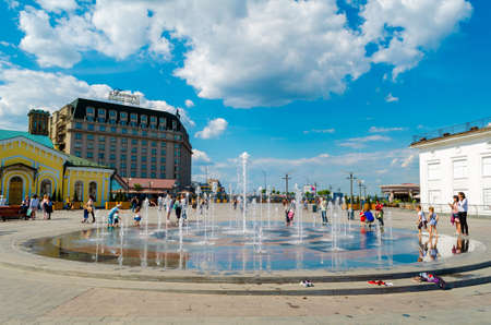 KYIV, UKRAINE - MAY 23, 2017 Kyiv. Capital of Ukraine. Happy kids have fun playing in city water fountain on hot summer day near River Station at Postal Square in Kyiv
