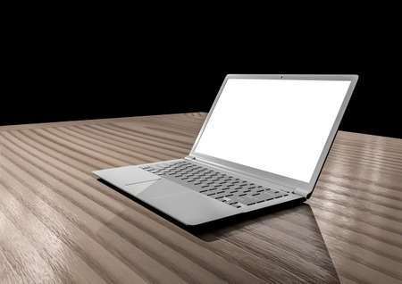 Laptop computer mockup with white blank screen on wooden table