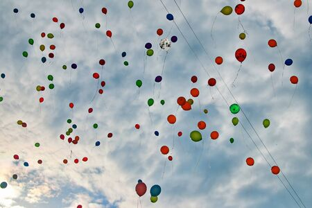 a lot of multicolored balloons in the blue sky