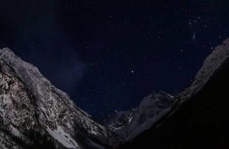 starry sky at night in the snowy mountains Archivio Fotografico