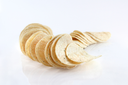 spice isolated: Potato chips with spice isolated on white background