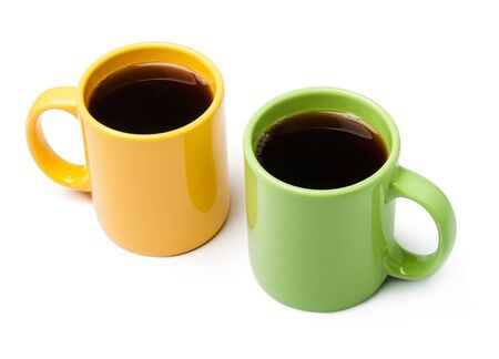 Two coffee mugs on white background photo