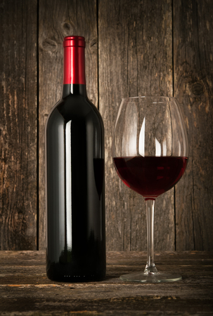 merlot: Bottle of red wine and glass