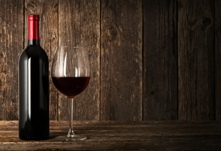 wineglass: Bottle of red wine and glass