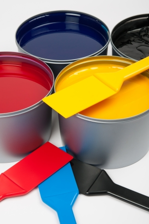 Printing inks  cmyk  and trowels photo