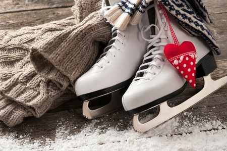 wooden figure: White ice skates on old wooden boards