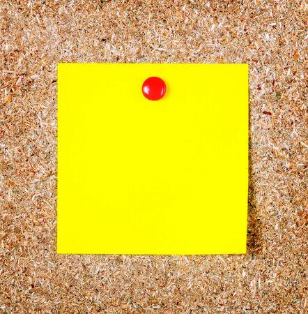 cork sheet: Yellow note paper on a cork board  Closeup Stock Photo