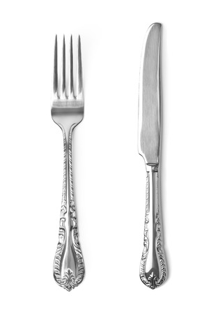 Vintage knife and fork on white background photo