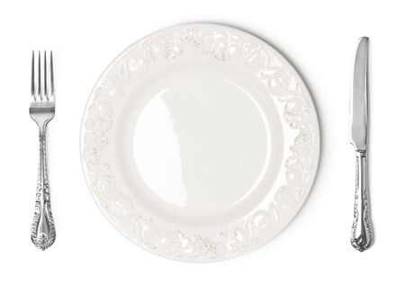 Vintage plate, knife and fork on white background photo