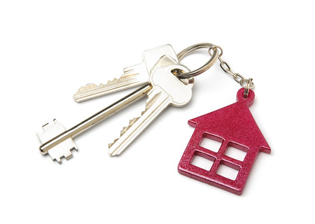 key in chain: House shaped key chain isolated on white background