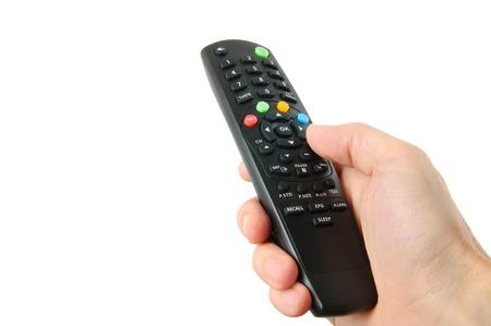 白で隔離の手でテレビのリモコン 写真素材