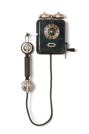 Black old wall telephone on white background Standard-Bild