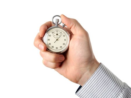 timescale: Closeup of hand holding stopwatch, isolated on white background Stock Photo