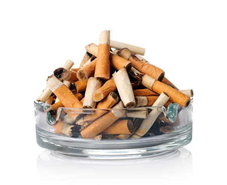 ashtray: Cigarette butts in the ashtray on white