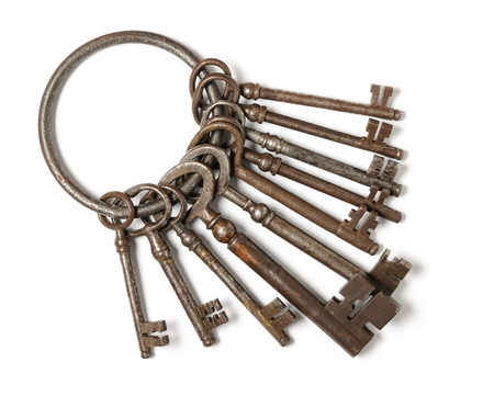 jailer: Bunch of old keys isolated on white
