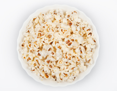 Bowl of popcorn on grey background. Top view