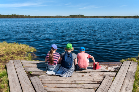 Family summer vacation on the forest lake. Travel, tourism and people concept