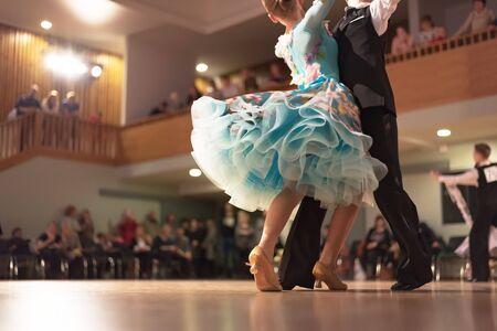 Beautiful couple in active ballroom dance