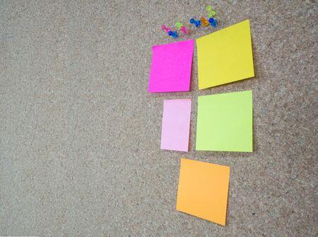 memorandum: Group of thumbtacks pinned and colorful memorandum notes on cork board bulletin board