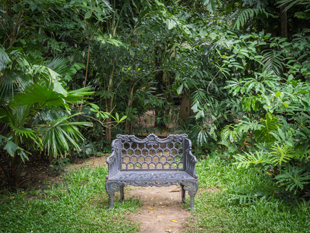 cast iron: Vintage cast iron bench in the garden Stock Photo