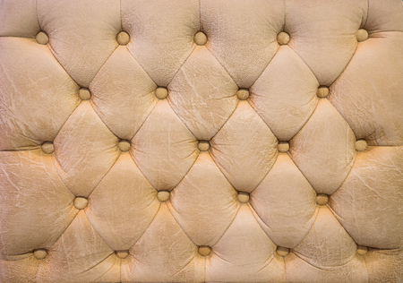 antique booth: Vintage beige leather upholstery buttoned sofa background