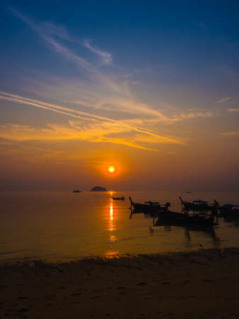 sea fishing: Beautiful Sunrise and silhouette local fishing boats on sea at the beach of Lipe island ,Andaman sea, Satun, Thailand. Stock Photo