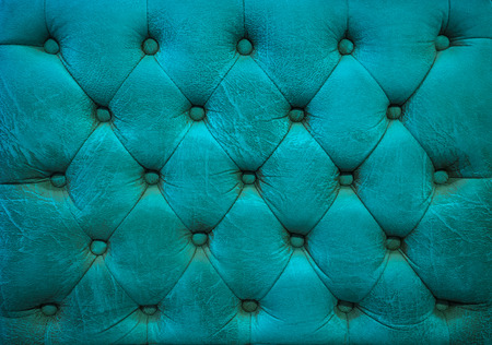 blue leather sofa: Vintage ocean blue leather upholstery buttoned sofa background