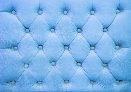 antique booth: Vintage blue sky leather upholstery buttoned sofa background Stock Photo