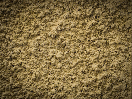 knobby: Yellow knobby cement wall for background Stock Photo