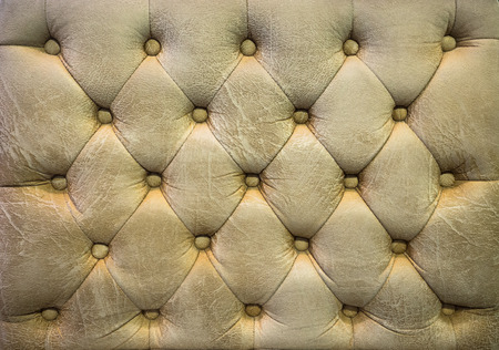 buttoned: Vintage blond color leather upholstery buttoned sofa background