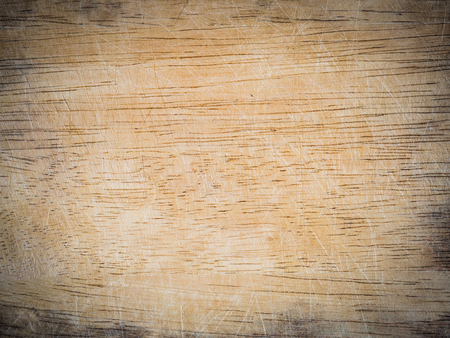 wooden chopping board with scored surface texture for background