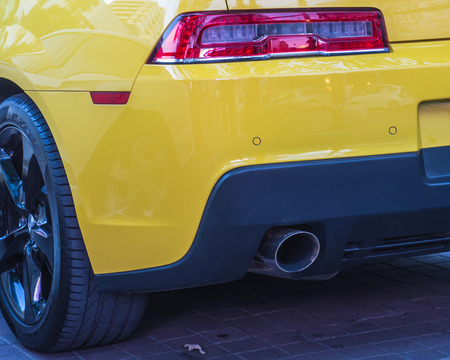Exhaust pipe of yellow car