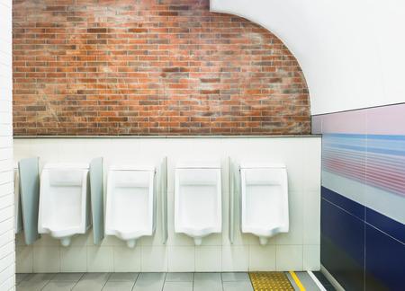 latrine: Urinals in public men toilet room