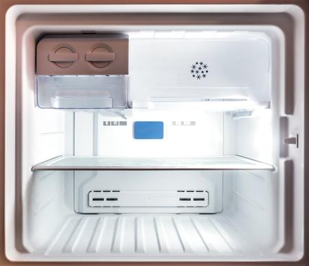 Close up inside an empty white freezer fridge (refrigerator) Archivio Fotografico