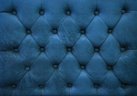 blue leather sofa: Vintage indigo blue leather upholstery buttoned sofa background Stock Photo