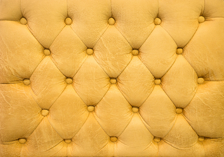 buttoned: Vintage cream leather upholstery buttoned sofa background Stock Photo
