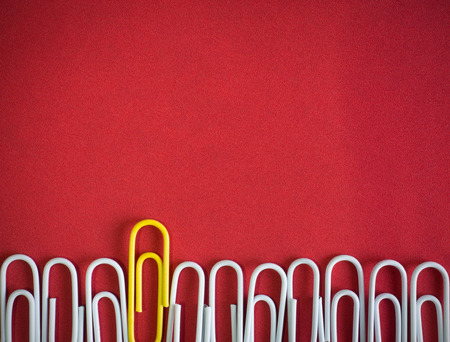 symbolize: Paper clips arrange to symbolize to be different or  leadership like boss