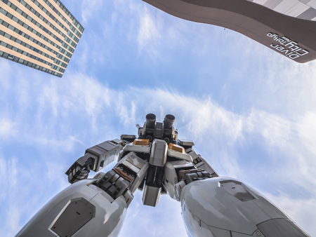 ODAIBA, TOKYO, JAPAN - MARCH 30, 18-meter Mobile Suit Gundam RX78 robot shoot in front of DiverCity Tokyo Plaza, Odaiba which shoot from the bottom view. Gundam is a well-known Japanese robot animation.