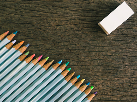 resolving: Colorful pencil and rubber arrange on the wooden table symbolized to be a forgiveness,resolving with copy space (vintage tone)
