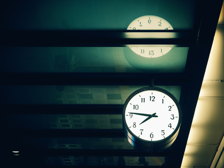 Wall clock hang in the train station, wall clock show time almost eight pm with copy space (vintage tone)