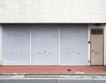 Metallic shutter roller gate in front of a store shop